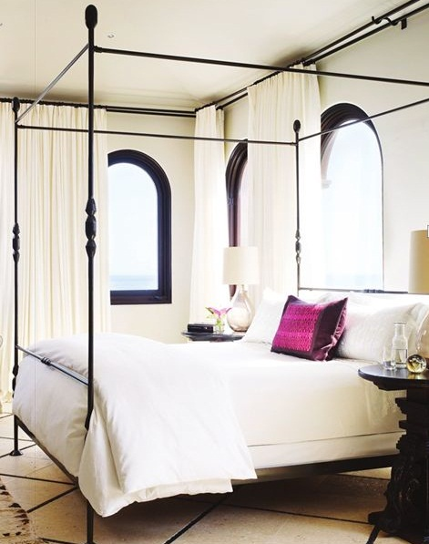 Black Iron canopy bed on white bedroom with dark contrasting accents and a spot of bright color pictures 12