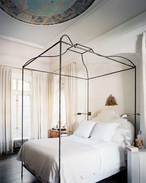 Inspiring iron canopy bed dressed with white linens Pictures 010