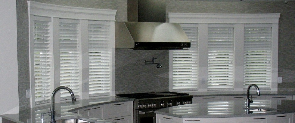 Elegant Faux Wood Blinds In Kitchen Space