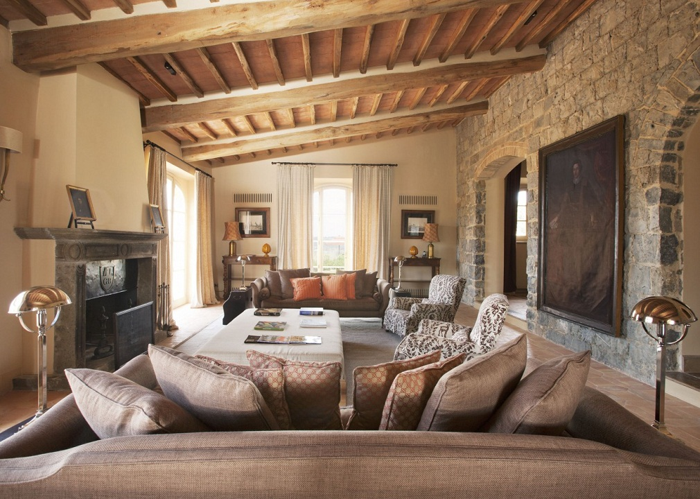 Tuscan style living room ideas with beige sofa and wooden round coffee table home interior for Tuscan living room furniture