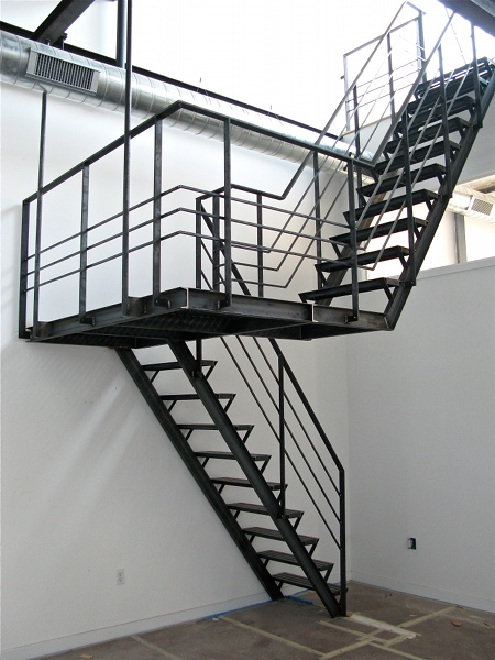 Black Switchback Stairs With Floating Home Interior