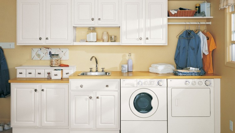 Laundry Room Storage Cabinets With Sink And Wooden Countertop