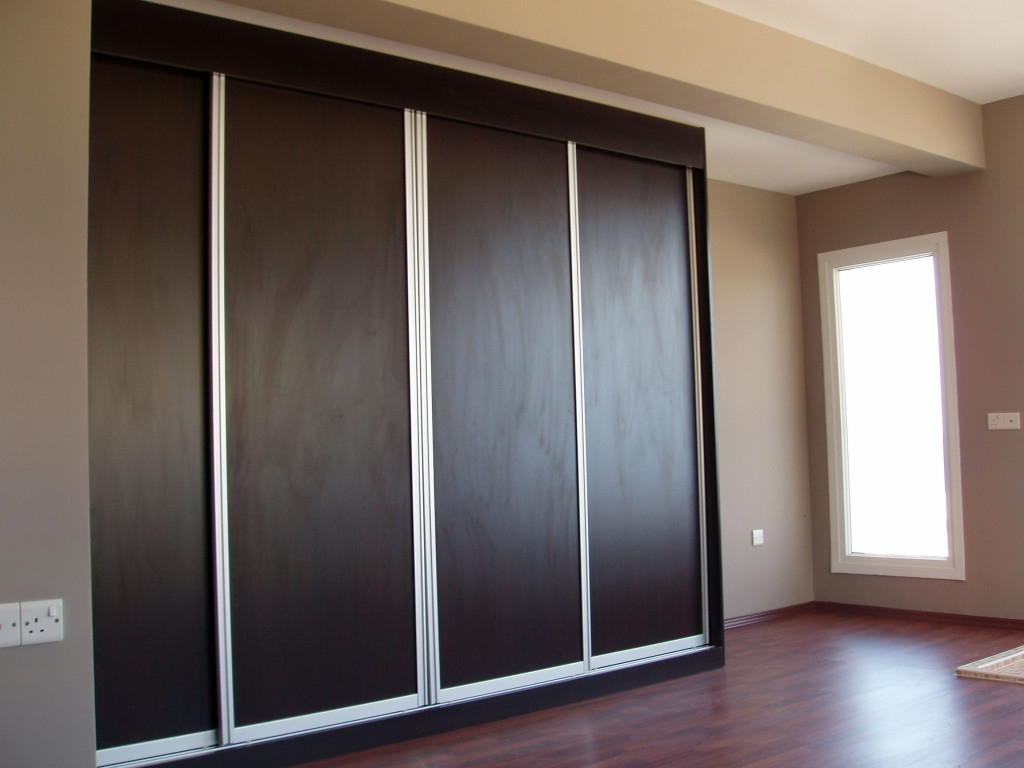 Attractive Minimalist Solid Black Enclosed Wardrobe Closet Design Pertaining To Black Closet Door