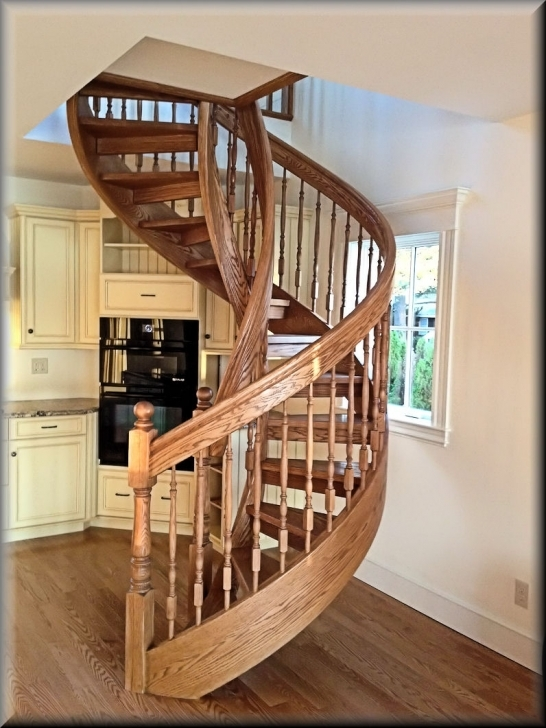 Beautiful wooden spiral staircase design home interior for Spiral staircase design plans