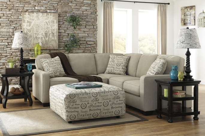 Ashley Furniture Sectional Sofas With Ottoman Coffee Table And Sisal Carpet Also Stacked Stone Accent Wall Pic