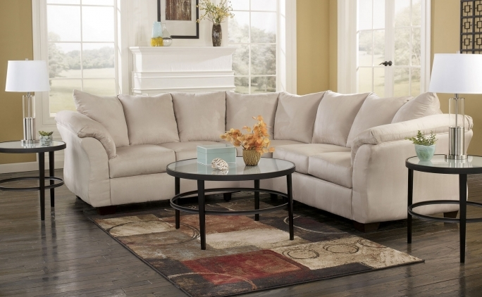 Ashley Furniture Sectional Sofas With Round Glass Coffee Table And Flower Vase American Furniture Photos