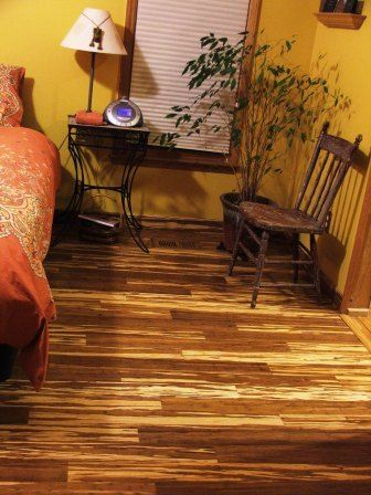 Cozy Bamboo Flooring With Yellow Walls With Tiger Strand Marble Style