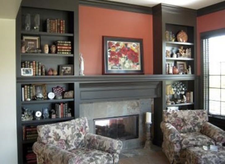 Attractive Built In Bookshelves Around Fireplace In Dark Color Image