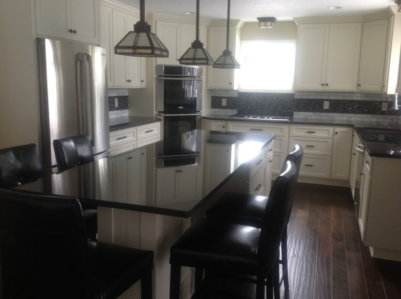 Classy Black Quartz Countertops With Rustic Pendant Lamps And Dark Leather Chairs Photos