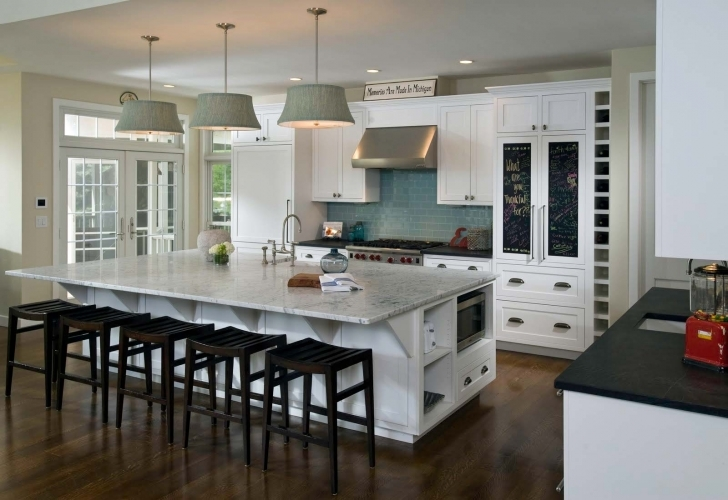 Cozy Floating Kitchen Island With Seating With White Color Interior Cabinet Countertops And Hanging Lamps Pic