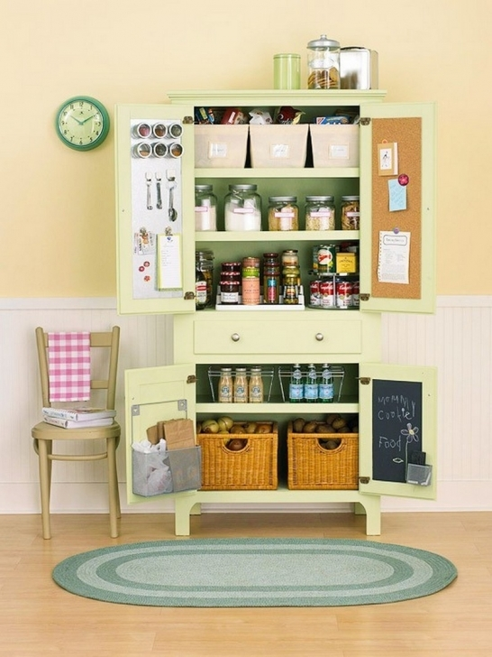 Kitchen Pantry Cabinet Ideas Regarding Small Green Wooden Kitchen Pantry With Chair And Ovel Rug Image