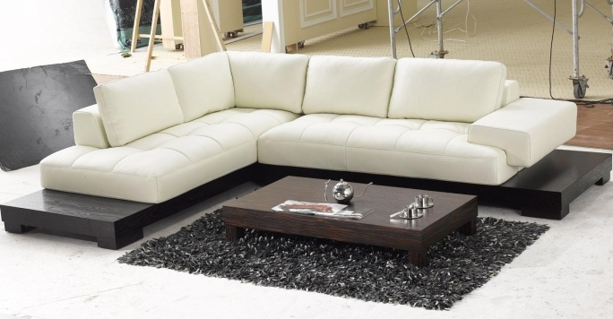 Ashley Furniture Sectional Sofas Chic Beige With Coffee Table And Shag Rug For Living Room Pic