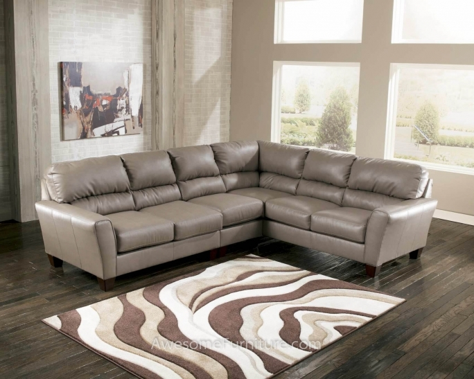 Ashley Furniture Sectional Sofas With Area Rug And Window Treatment For Family Room Pic